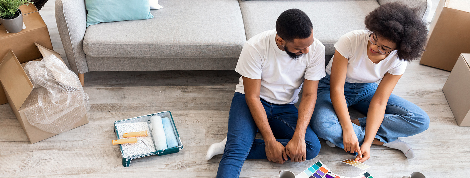 Couple Sitting On Floor Looking at Paint Swatches
