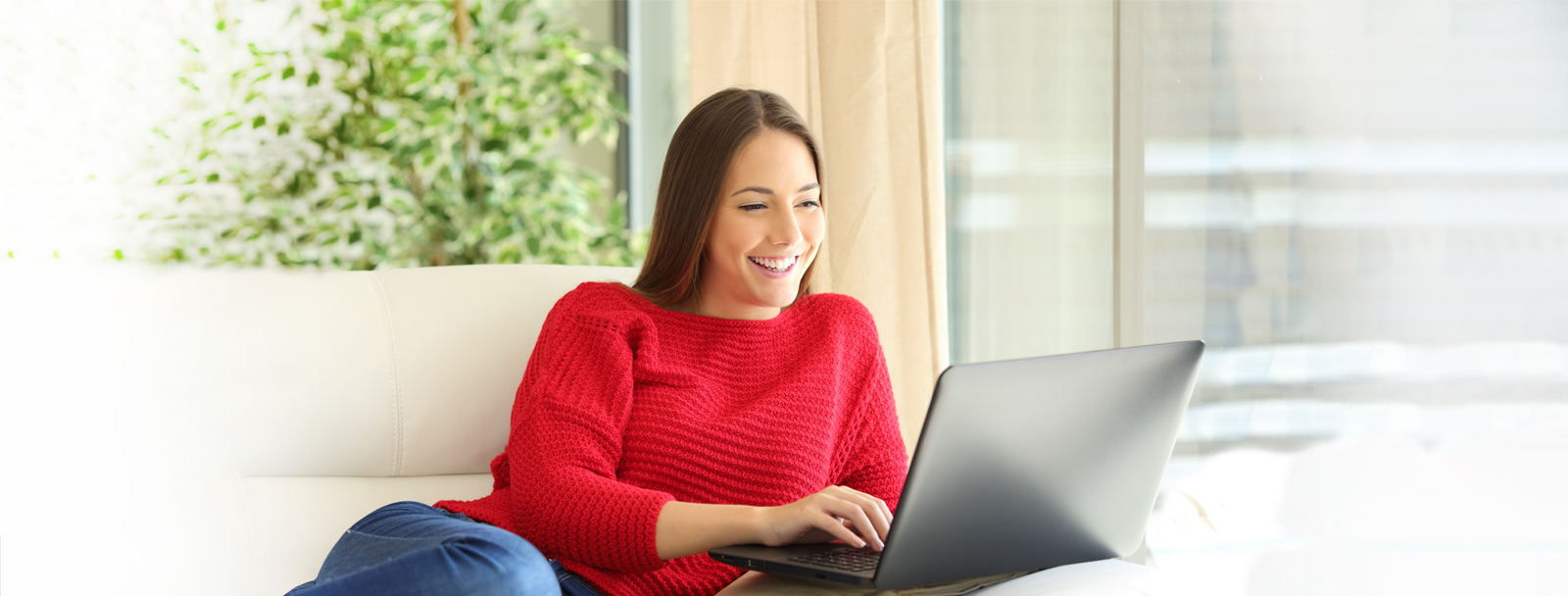 Girl in red sweater on laptop extended